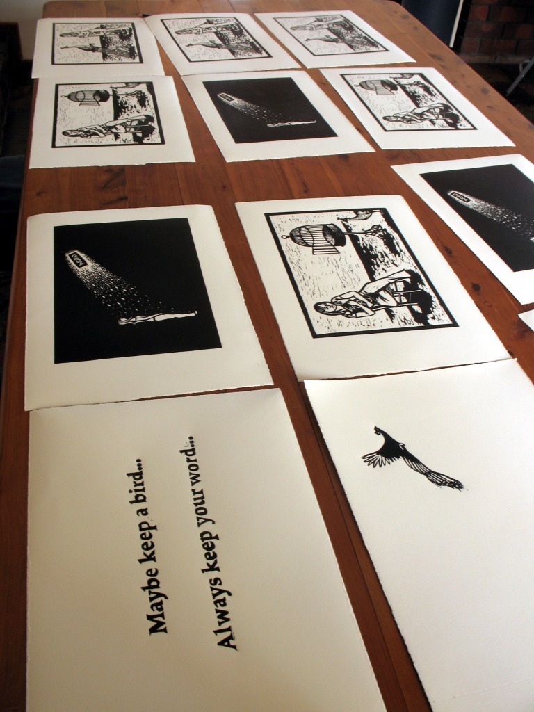 Lino prints layed out to dry.